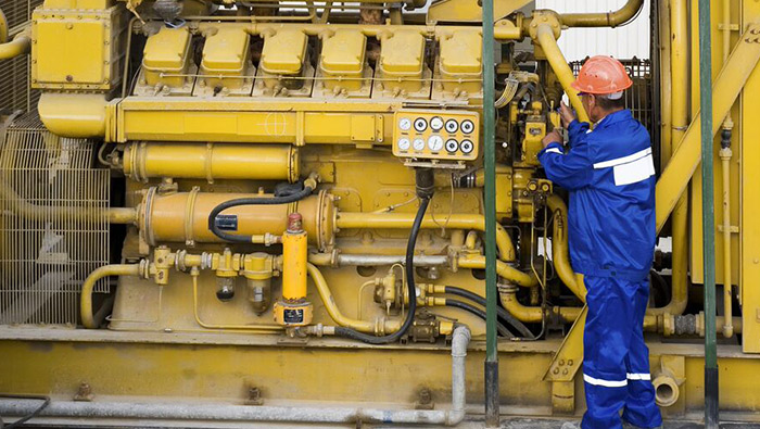 Worker fixing a large piece of machinery